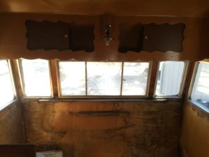 upper cabinet and table bracket; water damaged wood paneling